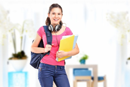 A smiling female student with headphones posing Stock Photo - 14674465