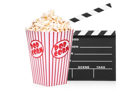 A studio shot of an open movie clap and popcorn box isolated on white background photo
