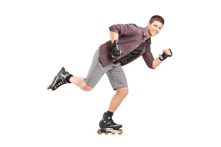 Full length portrait of a handsome man roller skating isolated on white background photo