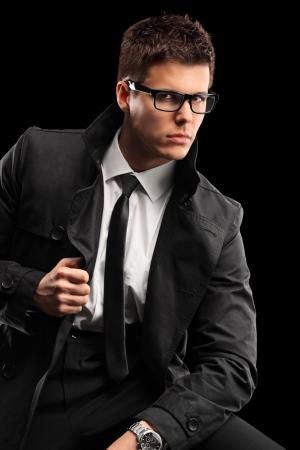 Young fashionable man isolated on black background photo
