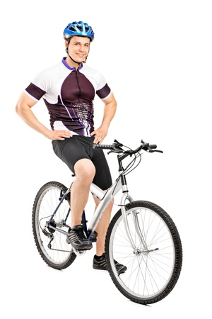 bicyclists: Full length portrait of a smiling bicyclist posing on a bicycle isolated against white background Stock Photo