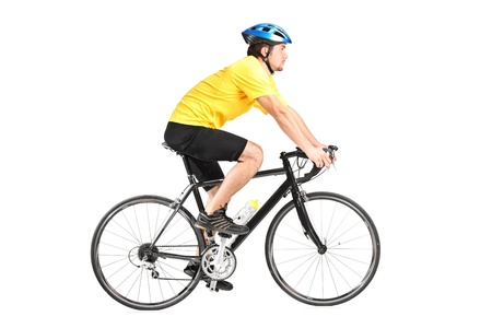 Full length portrait of a man riding a bycicle isolated against white background photo