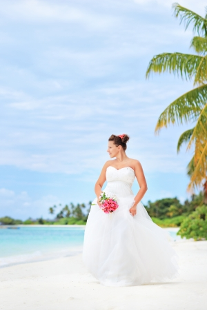 Young bride on a beach in Kuredu resort, Maldives island, Lhaviyani atoll photo