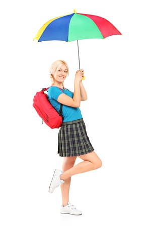 Full length portrait of a smiling female with school bag holding an umbrella isolated on white background Stock Photo - 14699505