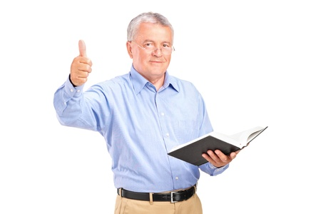 A male teacher holding a book and giving a thumb up isolated on white background photo