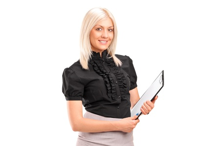A young businesswoman holding a clipboard isolated against white background Stock Photo - 14699471