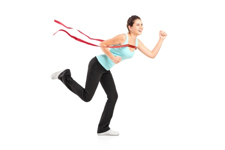 Full length portrait of a female runner winning a marathon, isolated on white background photo