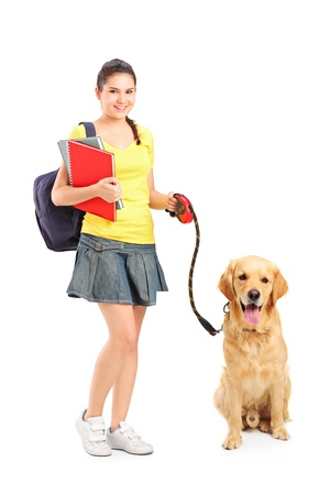Full length portrait of a female student with dog isolated on white background photo