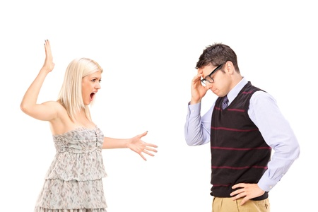cheat: Young couple having a fight isolated on white background