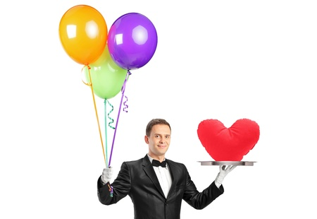 A butler holding balloons and a tray with a heart shape object isolated on white photo