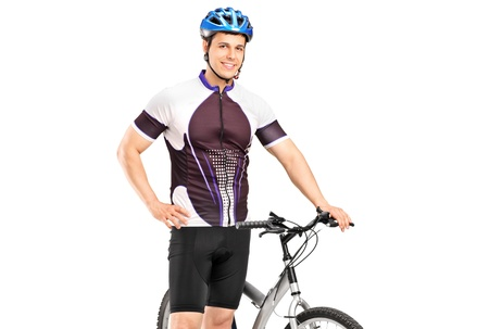 A smiling bicyclist posing next to a bicycle isolated against white background photo
