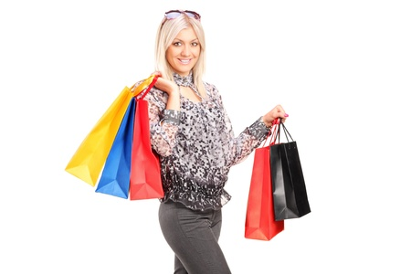 A blond female posing with shopping bags isolated against white background Stock Photo - 15198663