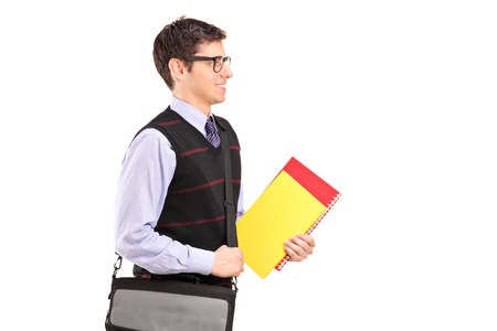 A student walking with notebooks in  his hand isolated on white background photo