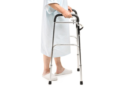 An old patient using a walker isolated against white background Stock Photo - 15198671