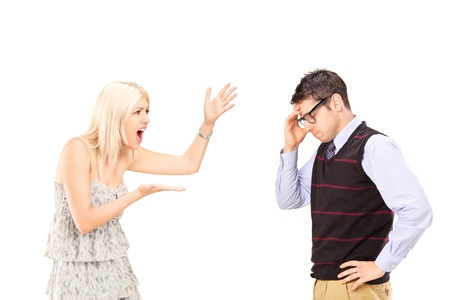 Angry woman shouting at a man, isolated on white background Stock Photo - 15198685