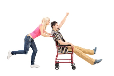 euphoric: Full length portrait of a happy female pushing a man in wheelchair
