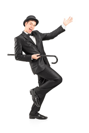 Full length portrait of a performer dancing with a cane isolated on white background photo