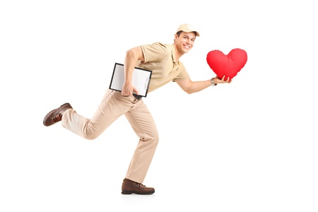 A delivery boy in a rush delivering red heart shaped object isolated against white background photo