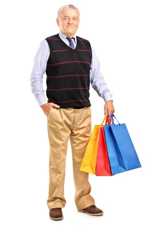 Full length portrait of a mature man with shopping bags isolated on white background Stock Photo - 15210119