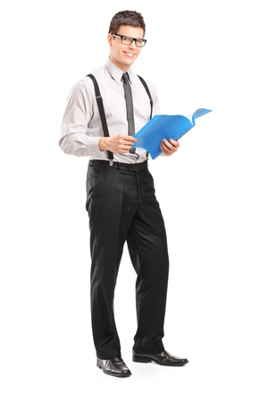 fascicule: Full length portrait of a professional young man holding a fascicule isolated on white background