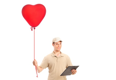 A delivery boy delivering a red heart shaped balloon isolated on white background photo
