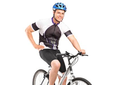 Male biker with helmet posing on a bike Stock Photo - 14943110