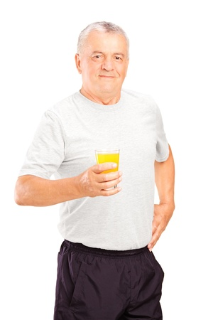 alcoholic man: Mature athlete holding a glass of orange juice, refreshing after an exercise, isolated on white background