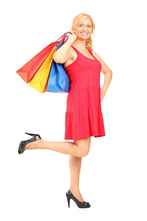 Full length portrait of a mature woman holding shopping bags isolated on white background Stock Photo - 15361432
