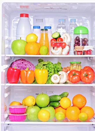 refrigerator: Shot of an open fridge with healthy food products