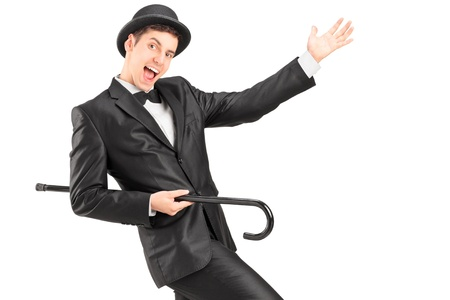 A performer dancing with a cane isolated on white background