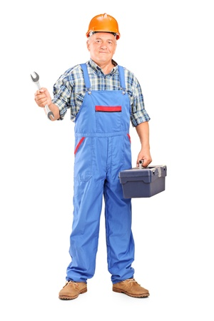 Full length portrait of a manual worker holding a wrench and tool box isolated against white background photo