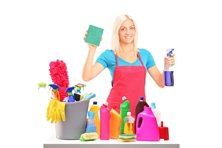 housewife gloves: Young female cleaner with cleaning equipment isolated on white background Stock Photo