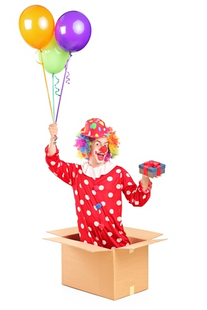 Clown holding balloons and a gift in a cardboard box, isolated on white background Stock Photo - 15452206