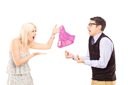 Young couple having a fight because of underwear isolated on white background photo