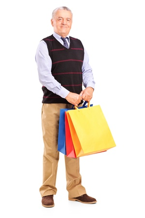 Full length portrait of a gentleman holding shopping bags, isolated on white background Stock Photo - 15636191