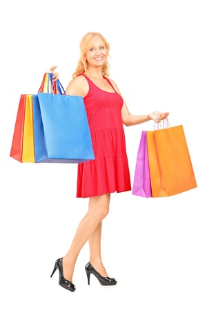 Full length portrait of a mature woman holding shopping bags isolated on white background Stock Photo - 15636194