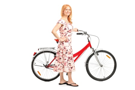 Full length portrait of a mature woman with bicycle isolated on white background photo