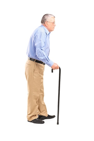 Full length portrait of a senior man walking with a cane isolated on white background Stock Photo - 15636204