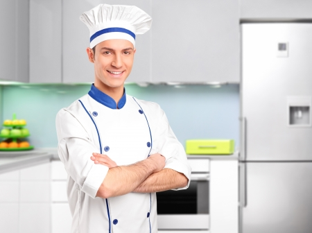 Male chef standing in a kitchen photo