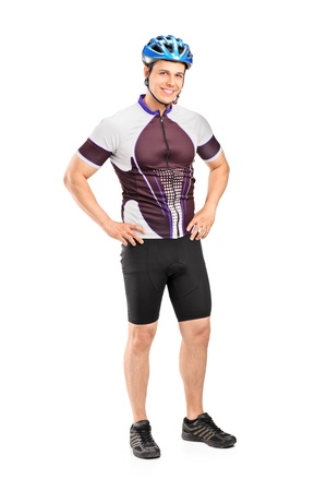 Full length portrait of a male biker wearing helmet and posing isolated on white background photo