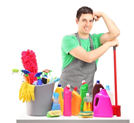 household objects equipment: Young male cleaner with cleaning equipment isolated on white background Stock Photo