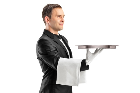 A butler with bow tie carrying an empty tray isolated against white background photo