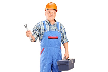 A manual worker holding a wrench and tool box isolated against white background photo
