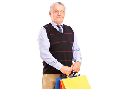 A gentleman holding shopping bags isolated on white background Stock Photo - 15762902