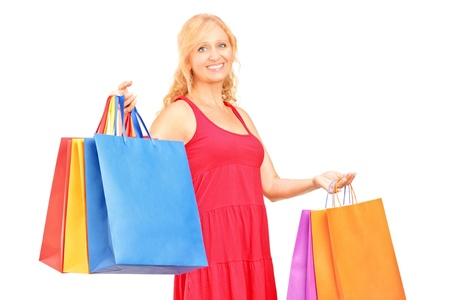 A mature woman holding shopping bags isolated on white background Stock Photo - 15762903