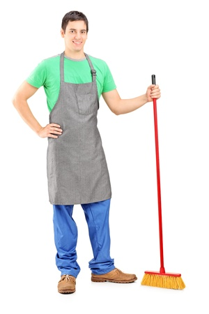 Full length portrait of a man cleaner posing with brush in his hand isolated on white background Stock Photo