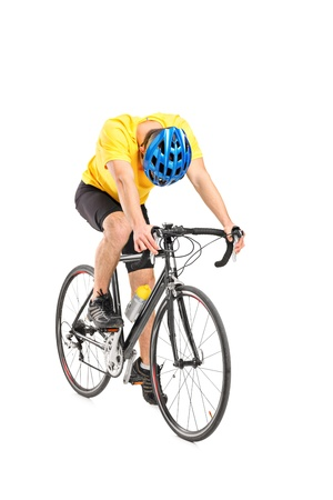 exhausting: Full length portrait of a tired cyclist on a bicycle isolated against white background