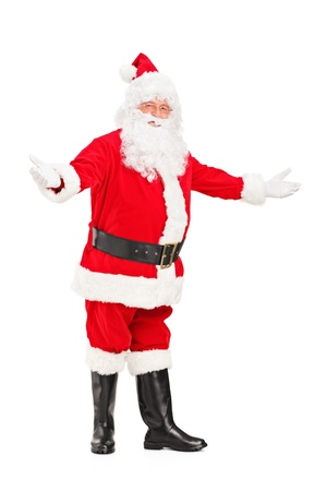 Full length portrait of a happy Santa Claus gesturing welcome isolated against white background