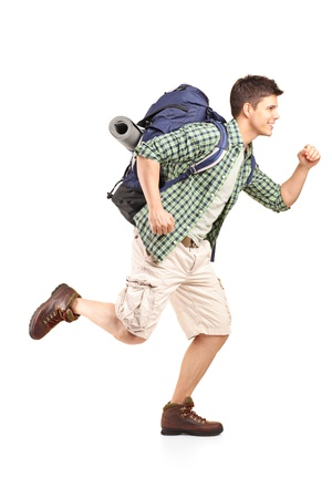 backpacking: Full length portrait of a hiker with backpack running isolated on white background