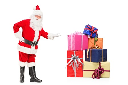 Full length portrait of a smiling Santa Claus offering presents isolated on white background photo